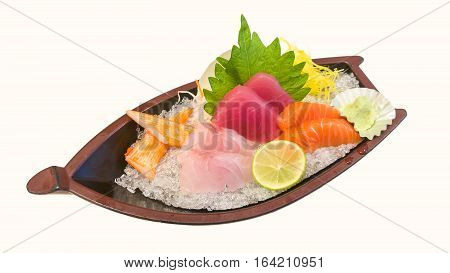 Japanese style assorted sashimi set with crab stick on dish laid over crushed ice