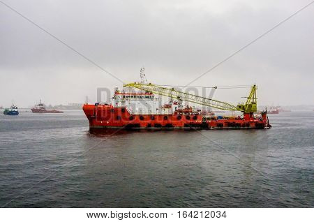 Labuan,Malaysia-Dec 4,2014:View offshore oil & gas sub sea construction & support vessel during raining at Labuan.The island strategically located for oil exploration & production region