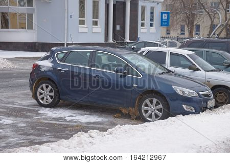 SARANSK, RUSSIA - JANUARY 6, 2017: Opel Astra J parked on city street. Photo taken at cloudy day.