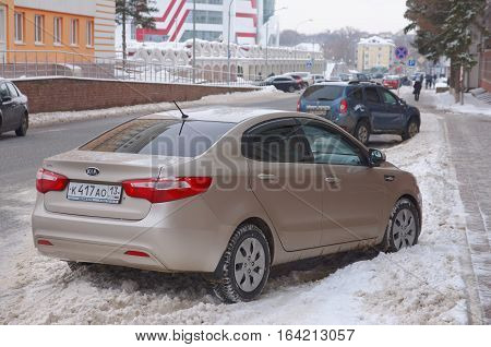 SARANSK, RUSSIA - JANUARY 6, 2017: Kia Rio sedan parked on city street. Photo taken at cloudy day.