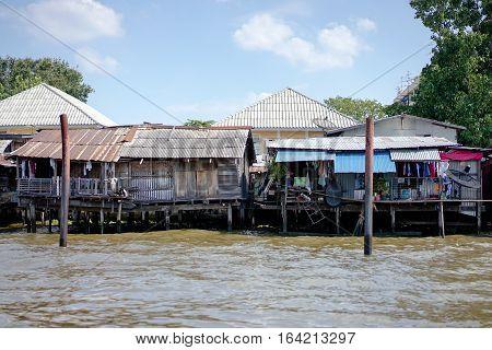 slum river side with nice sky ,Bangkok,Thailand