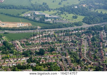 Aerial view across the Berkshire village of Datchet across the M4 motorway towards Ditton Park and the headquarters of CA Technologies. Sunny morning Summer.