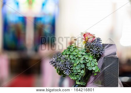 Close up view of a fake flower with blur background