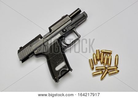 9 mm pistol gun and bullets isolated.