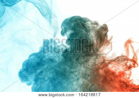 Abstract smoke Weipa. Personal vaporizers fragrant steam. The concept of alternative non-nicotine smoking. Blue red vape smoke on a white background. E-cigarette. Evaporator. Taking Close-up. Vaping.