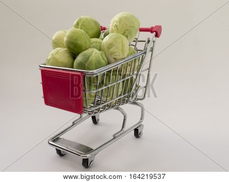 Fun truck with small Brussels sprouts on withe background