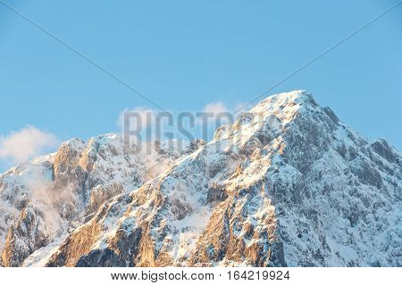 The peak of the Grimming mountain during sunset. Mountain in the Austrian Alps.