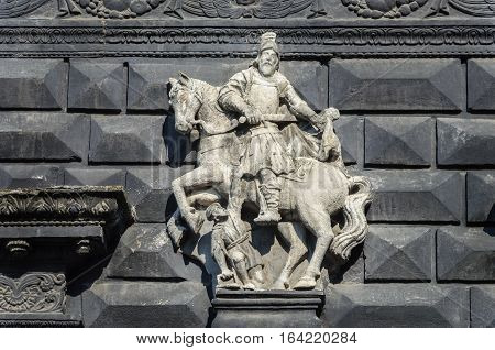 Ancient sculpture of St. Martin on the wall of the Black Kamenica in Lviv Ukraine