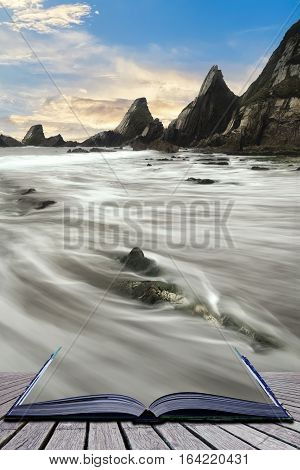 Stunning Colorful Sunset Over Beach Landscape With Jagged Rock Formations Coming Out Of Pages Of Boo