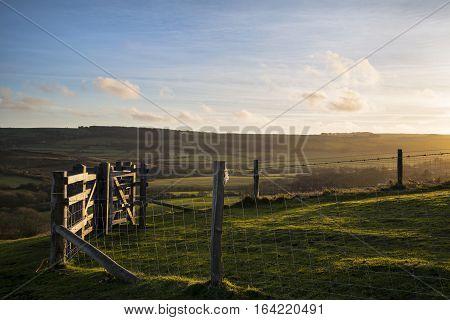 Beautifiul Late Winter Evening Sunlight Raking Across Stunning English Countryside Landscape
