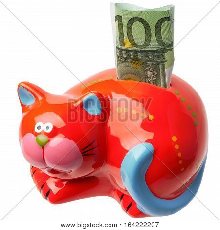 The red moneybox in the form of a cat with the note of 100 euros inserted into her is isolated on a white background