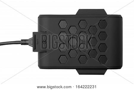 Black external hard drive with the inserted cable. Top view. Portable disk is isolated on a white background