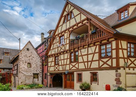 street with historical houses in Riquewihr Alsace France