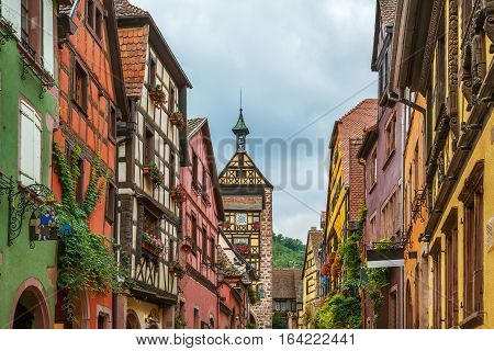 Main street with historical houses in Riquewihr Alsace France