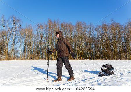 The photographer returned from winter shooting wildlife. Sleigh shooting equipment.