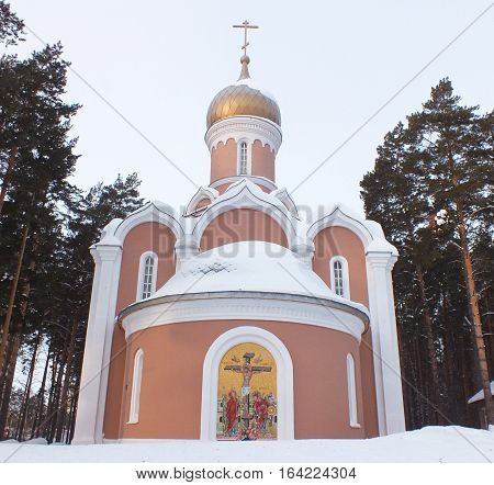 Orthodox church surrounded by pine in winter in Novosibirsk, Russia