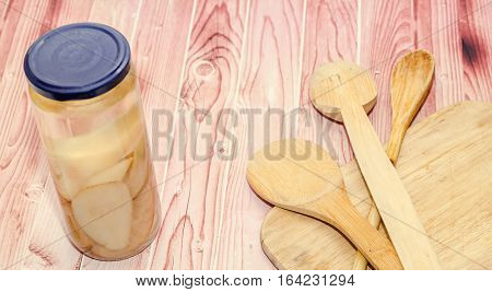Jar With Sliced Pears Compote, Wood And Spoons Backgroud.