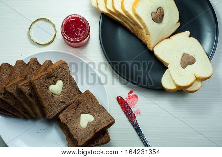 ,photo love bread. bread valentine. photo love delicious slice of bread with strawberry jam sweetener. is suitable for decorating the nuances of affection