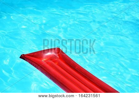 Red Inflatable Pool Raft In Pool On Sunny Day