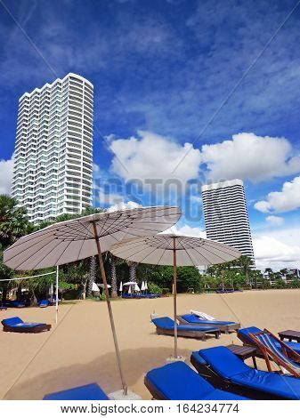 Beach lounge chairs and umbrellas in Pattaya