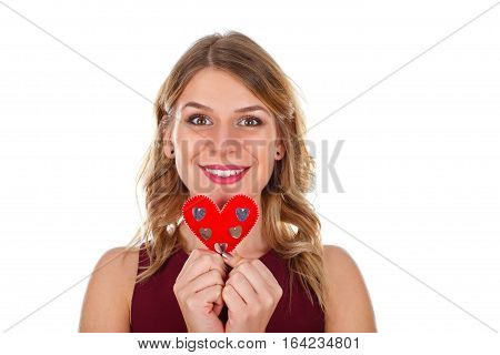 Picture of a beautiful young woman holding a little heart