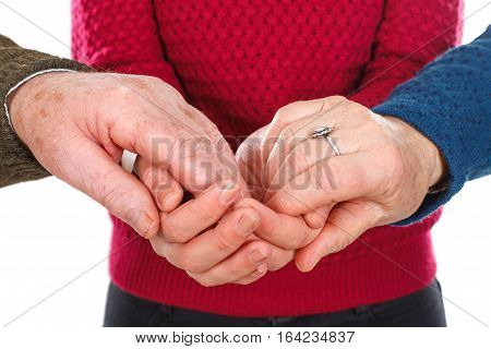 Close up picture of an old couple's hands held by their grandchild's