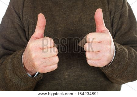 Close up picture of an elderly man showing thumbs up