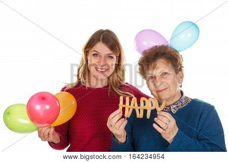 Picture of an eldery woman celebrating birthday with her granddaughter