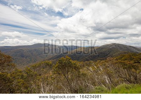 Mount Buller landscape over towards Mt Stirling and Corn Hill on a hot summer's day in Victoria, Australia