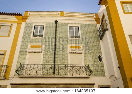 typical portugues palace with a facade full of tile evora portugal