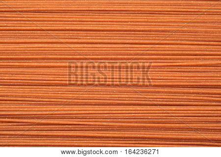 raw whole grain spaghetti pasta texture background