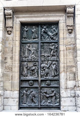 Paris France. Bronze gate works by the Italian master Tommaso Dzhismondy in the Church of St. Peter in Montmartre.