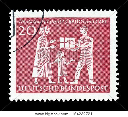 GERMANY - CIRCA 1963 : Cancelled postage stamp printed by Germany, that shows Helping.