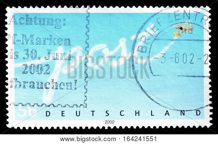 GERMANY - CIRCA 2002 : Cancelled postage stamp printed by Germany, that shows Post logo.