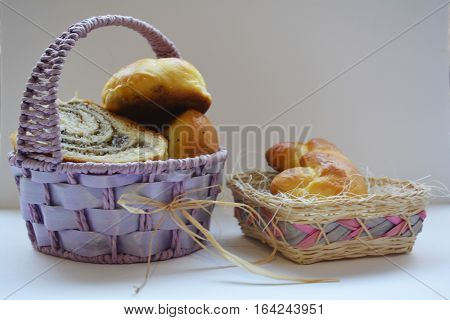 slices of sweet roll with nuts, and muffins in the basket