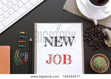 Text New job on white paper background / business concept
