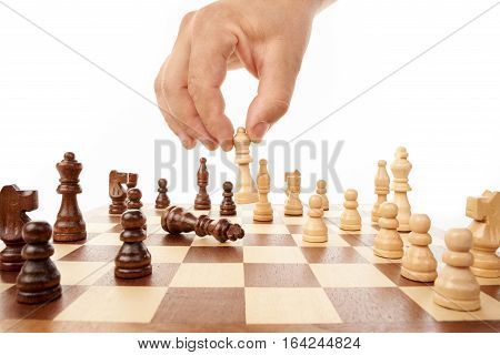 Chess game with hand on  white background