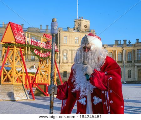 Gatchina, Russia - January 6, 2017: Christmas show for children on the parade ground in front of the Gatchina Palace. Santa Claus greets children.