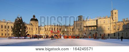 Gatchina, Russia - January 6, 2017: Gatchina Palace, New Year's Fair on the parade ground. Panorama on the background of the palace with a Christmas tree, fair.