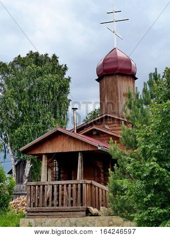 The small chapel in village. Summer, July. Ural, Russia
