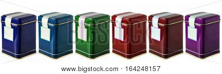 Colorful metal packaging tins or boxes for tea coffee dry products with blank label isolated on a white background