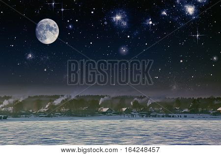 Sky full of stars with milky way.Winter landscape with village in mountains