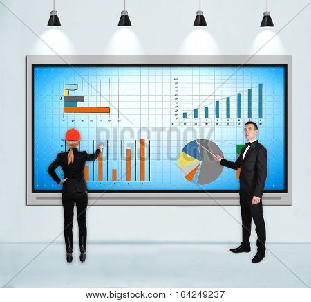 Businesspeople Pointing To Chart