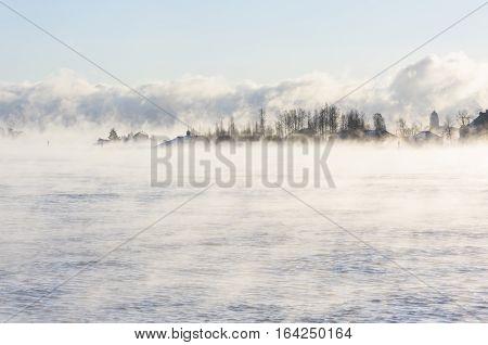 Island far in distance in a vaporizing sea