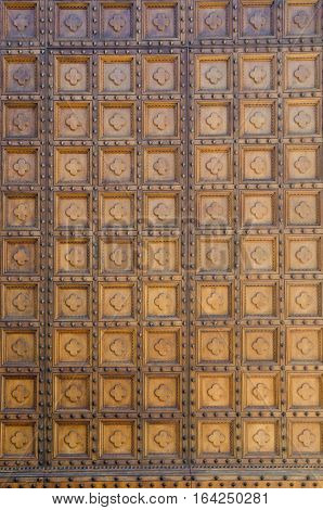 Detail shot of door pattern or texture of Il Duomo cathedral or church in Siena, Italy, Europe.