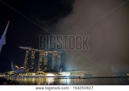 January 1 2016. A large cloud of smoke left from the fireworks fills up the skylines of Singapore's Mariana Bay Sands Hotel after the New Year's Day celebrations.