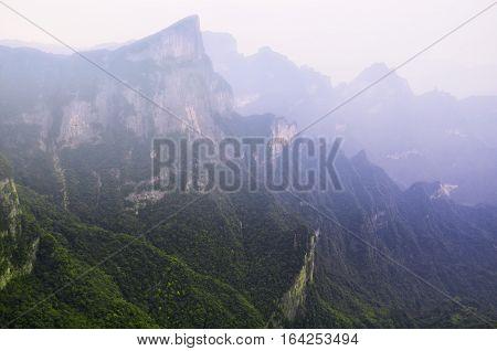 The mountains and rocky cliffs of tianmen or Tianmen shan near the city of Zhangjiajie in Hunan province China.