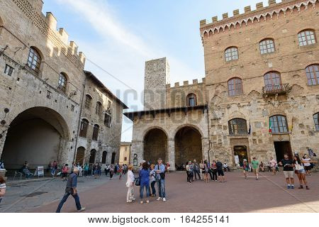San Gimignano Italy - September 24 2016: Tourists are visiting the famous town San Gimignano in tuscany Italy