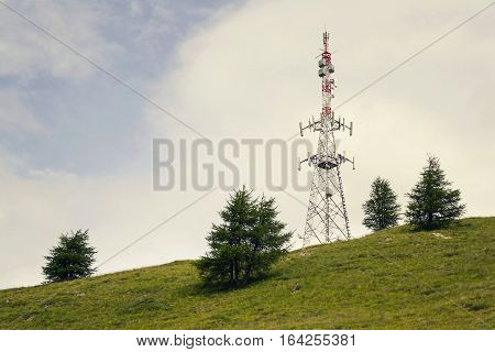 Filtered telecommunication tower on hill with copy space