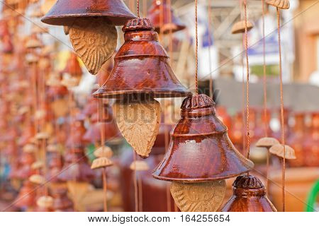 Designer bells made of clay handicrafts on display during the Handicraft Fair in Kolkata earlier Calcutta West Bengal India. It is the biggest handicrafts fair in Asia.